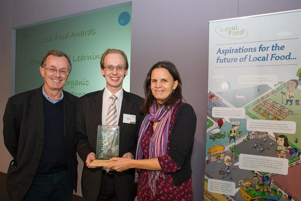 Master Gardener Philip Turvil (centre) accepts Local Food award