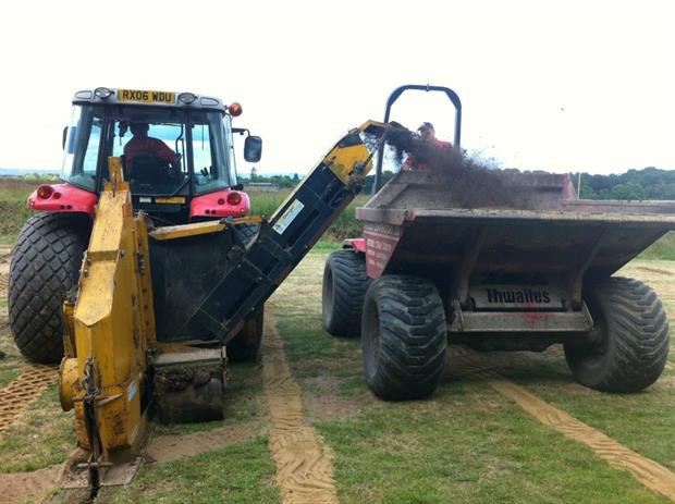 Speedcut at work on drainage at Lingfield Park Racecourse in Surrey.