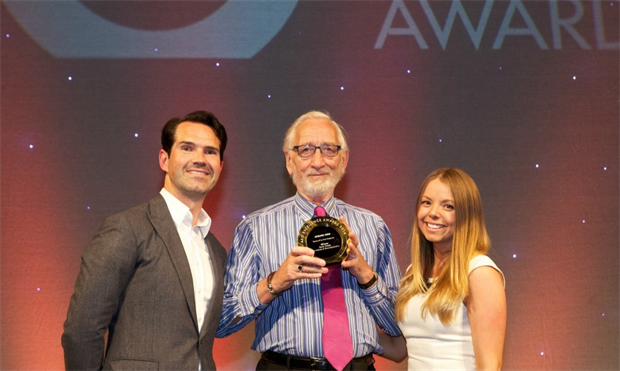Derek Walder, centre - receives his AEO Unsung Hero Award from TV personality Jimmy Carr and Samantha Edwards from category sponsor Event Magazine