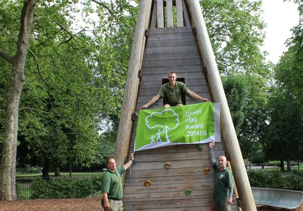 Queen's Park staff celebrate their green flag