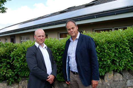 Dr Eavis (l) and solar panel installer Steve Barrett