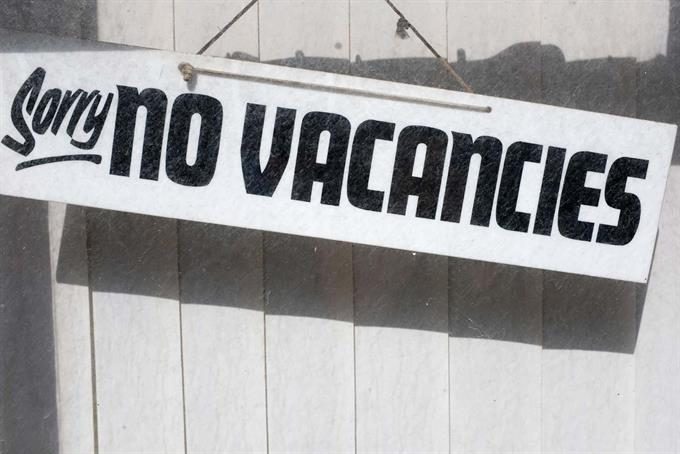 Junior job market facing 'crisis' as companies hit brake on hiring