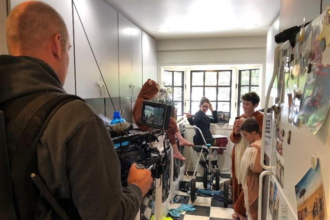 Inside chaotic Snuggle spot made in director's laundry room with family as actors and crew
