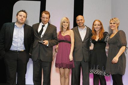 RadioCentre chief executive Andrew Harrison (third from right) presents MediaCom with the agency of the year award at the 2009 Radio Advertising Awards