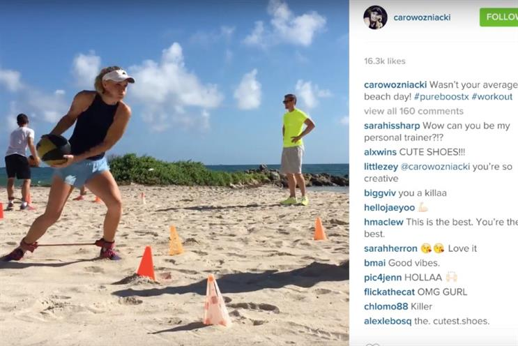 Caroline Wozniacki: trains on the beach with Adidas