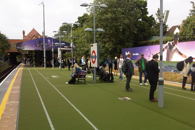Wimbledon: FedEx turns Southfields station into a lawn tennis court