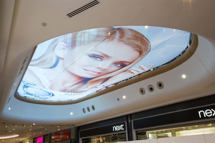 Citizen: takes over the giant atrium banner in the Bullring shopping centre, Birmingham