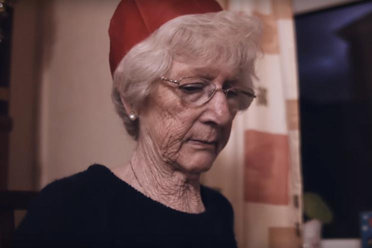 The charity's ad shows an old woman spending Christmas alone