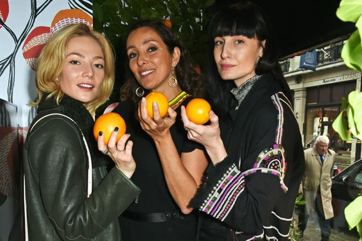 Guests have their photo taken by Cointreau and Liberty London photobooth