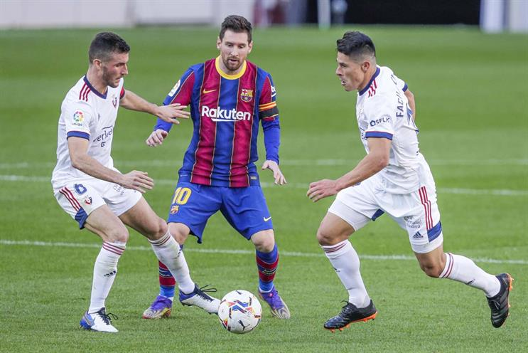 La Liga: Barcelona's Lionel Messi takes on players from Osasuna last month (Photo: Soccrates Images/Getty)
