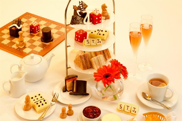 The afternoon tea features edible scrabble pieces and chocolate Monopoly hats