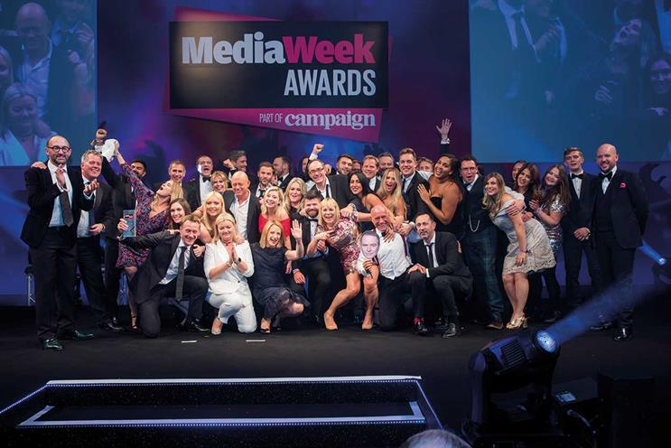 Media Week Awards: ITV receives Sales Team of the Year award, led by Simon Daglish, deputy managing director of commercial (in red socks), holding a cut-out of Kelly Williams, managing director of commercial, who was unable to attend