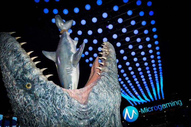 Microgaming deliver Jurassic World stunt at ICE Totally Gaming exhibition
