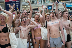 Naked protesters branded with TransferWise's campaign message
