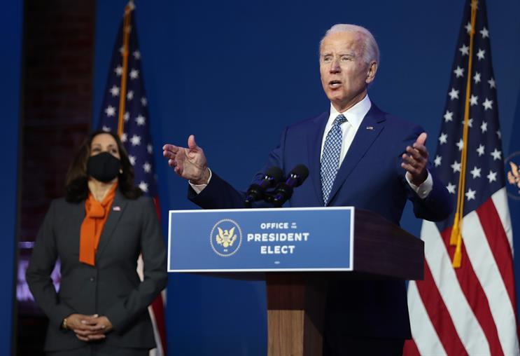Biden: flanked by vice-president-elect Kamala Harris (Joe Raedle/Getty Images)