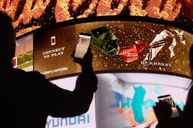 Burberry: consumers can personalise scarves before the results appear on Piccadilly Circus' Curve screen