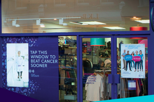 Cancer Research UK: winning campaign asked passersby to tap a window
