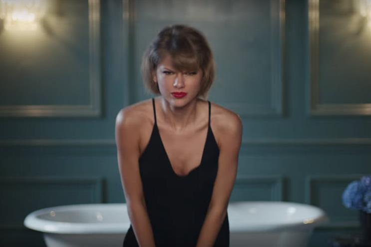 Taylor Swift: throwing some awkward shapes for Apple Music's latest spot
