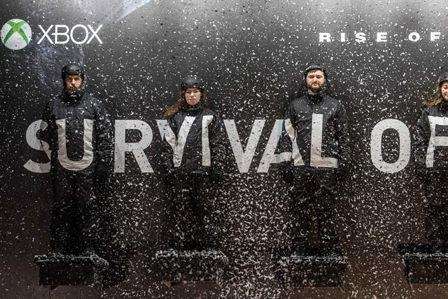 'Survival billboard': people stood on an outdoor billboard on a cold November night in London