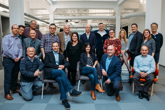 The partners who make up Allison+Partners at their 2019 meeting.