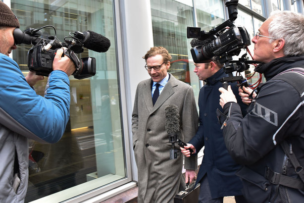 Cambridge Analytica boss Alexander Nix is mobbed by journalists ahead of his suspension as CEO (pic credit:Matthew Chattle/REX/Shutterstock)