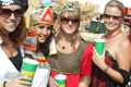 Bestival: revellers in 'Pirates and Wizards' fancydress hold Brothers-branded cups