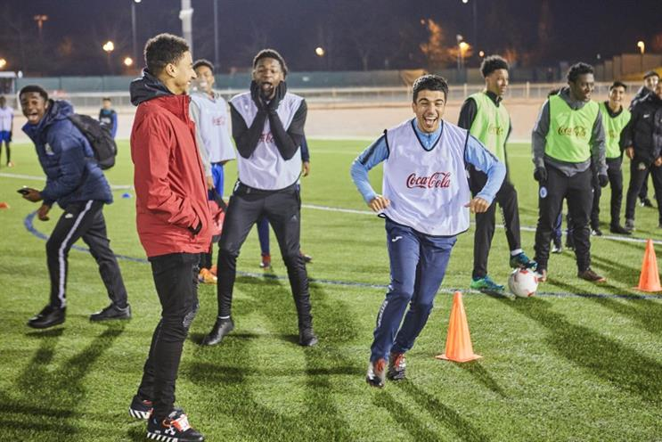 Manchester United star Jesse Lingard (in the red jacket)