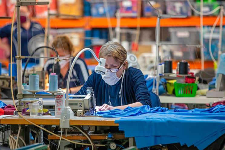 O'Neills sportswear staff making NHS scrubs. A quarter of Britons are more likely to buy from brands helping out. (Photo: Getty Images)