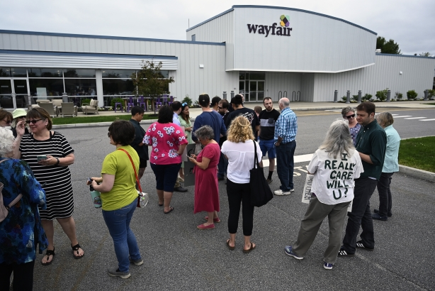 Employees, supporters and journalists gather as workers walked out of work at Wayfair in Brunswick. (Shawn Patrick Ouellette/Portland Press Herald via Getty Images)