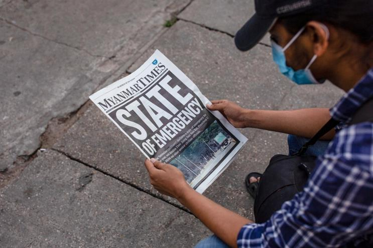 A man reading the national headline a day after Myanmar's military detained the country's de facto leader Aung San Suu Kyi and the country's president in a coup. (Getty Images)