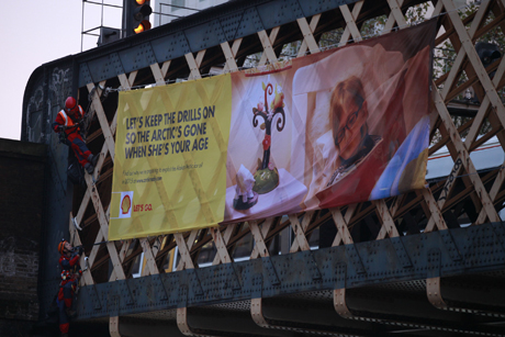 Greenpeace activists scaled a railways bridge outside Waterloo to unfurl their banner