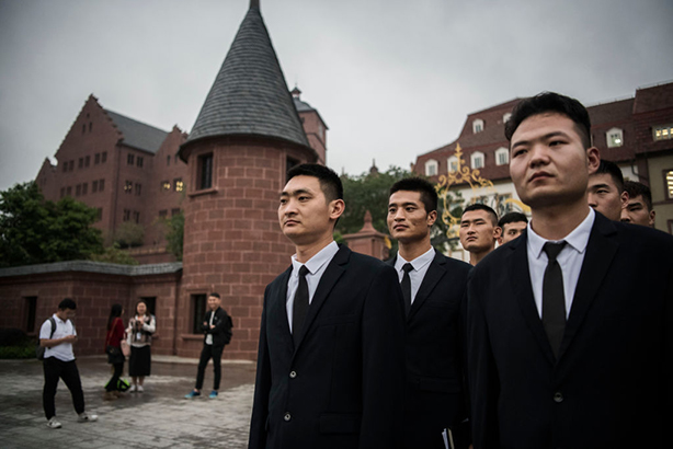 Huawei security guards at its Shenzhen headquarters in China. (Photo by Kevin Frayer/Getty Images)