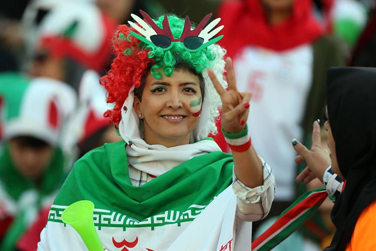 An Iranian fan attends a live football match for the first time. (Photos by Amin M. Jamali/Getty Images)