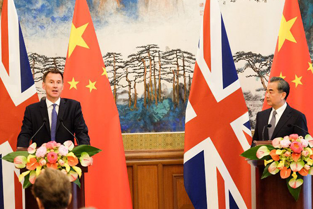 Foreign Secretary Jeremy Hunt (left) with Chinese counterpart Wang Yi (image via @Jeremy_Hunt on Twitter)