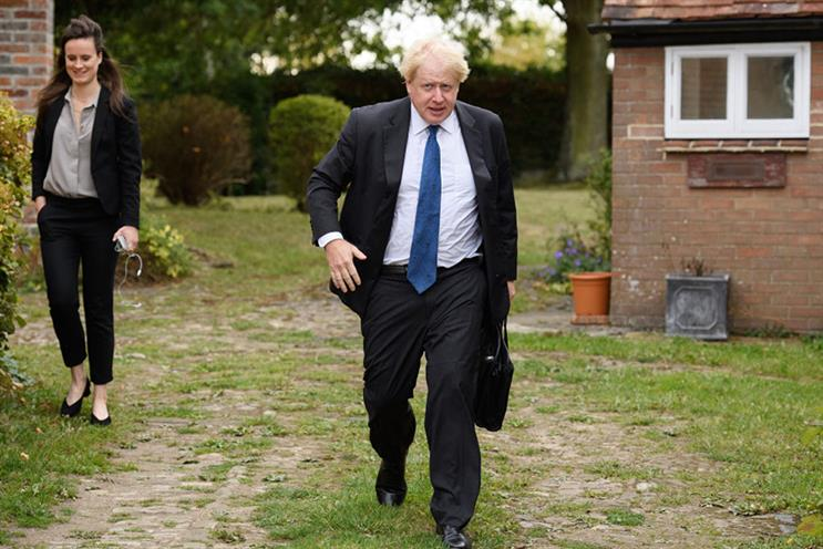 Boris Johnson leaves his home alongside Mimi Randolph, an employee of CTF Partners, in 2018 (©Leon Neal/Getty Images)