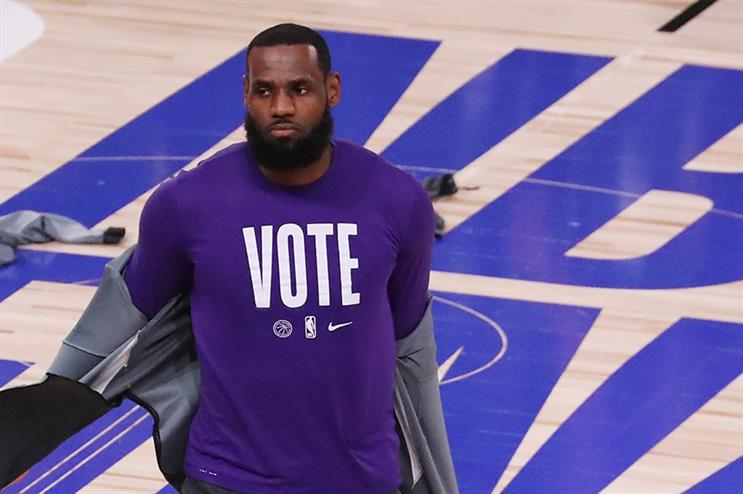 LeBron James wears a VOTE shirt during warm-up prior to the start of Game Five of the 2020 NBA Finals (Sam Greenwood/Getty Images)