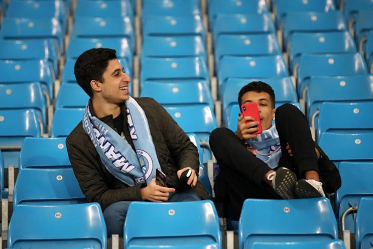 City fans enjoy a moment during their opening Champions League home fixture against Dynamo Zagreb. (Photo: Alex Pantling/Getty Images)