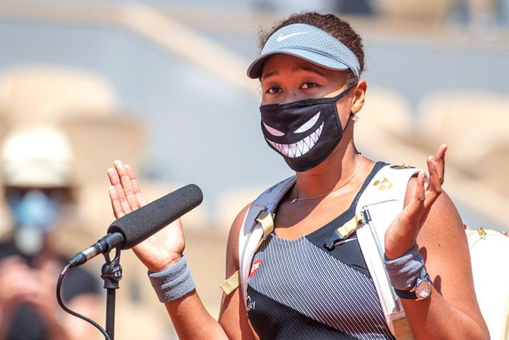 Naomi Osaka is interviewed on court following her first-round victory at the French Open. She would subsequently withdraw from the tournament citing mental health concerns (Photos: Getty Images)