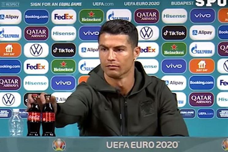 Cristiano Ronaldo moves two bottles of Coca-Cola at a Euro 2020 press conference