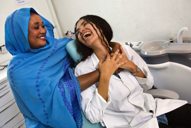 Colombian UN volunteer dentist Liliana Patricia Gutierrez Freyle and Darfuri staff Hawa Awadallah at Level 2 Hospital, El Fasher, Sudan