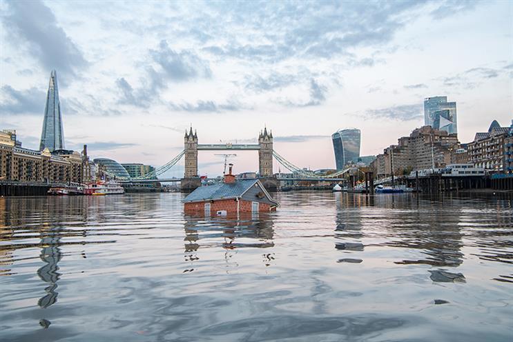 Extinction Rebellion sends 'sinking house' down Thames as flooding devastates the North