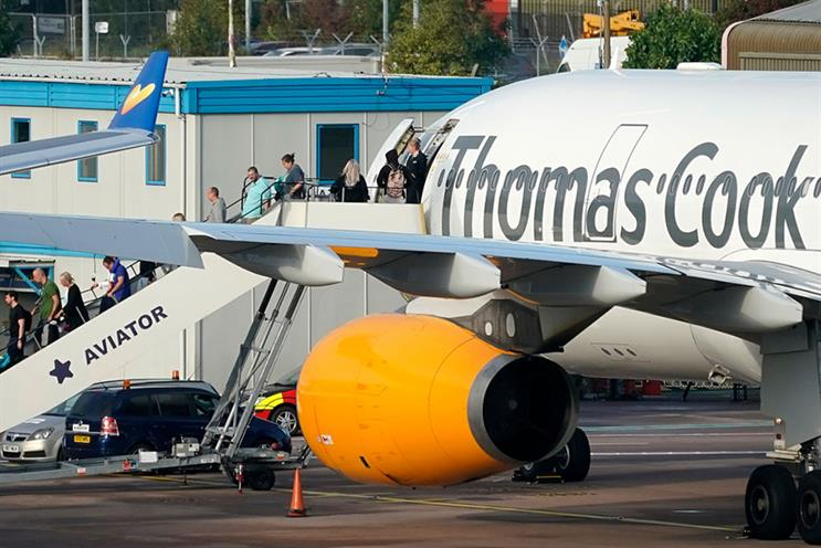 Passengers disembark a Thomas Cook plane in Manchester after the travel operator went bankrupt. (Photo by Christopher Furlong/Getty Images)