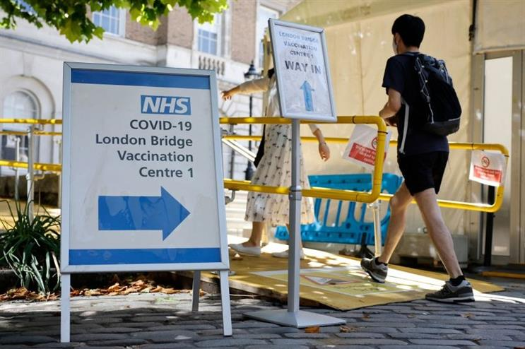 People arrive at the London Bridge Vaccination Centre on 9 August after coronavirus vaccinations were extended to 16- and 17-year-olds (photo by Tolga Akmen/AFP via Getty Images)