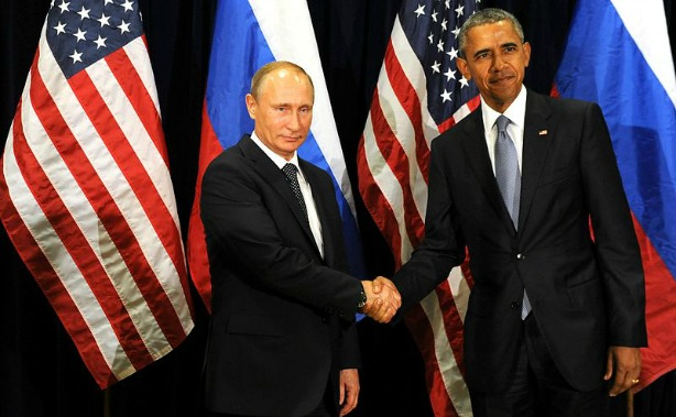 Presidents Putin and Obama share a rare friendly handshake. [Image credit: Wikimedia Commons attribute www.kremlin.ru]