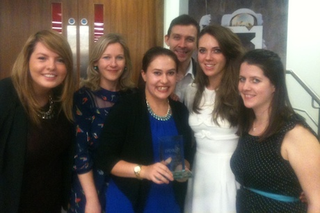Winner: Rhiannon Hughes with her trophy and her Whizz-Kidz colleagues