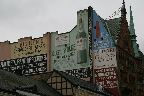 Adverts on a wall in Malmö, Sweden (Credit: Wrote via Flickr)