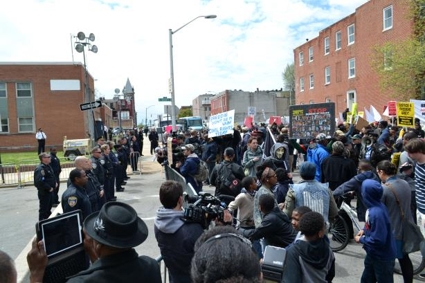 A protest at a Baltimore Police Department building. (Image via Wikimedia Commons).
