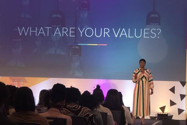 Jovian Zayne addresses ColorComm delegation during Living on Purpose session.