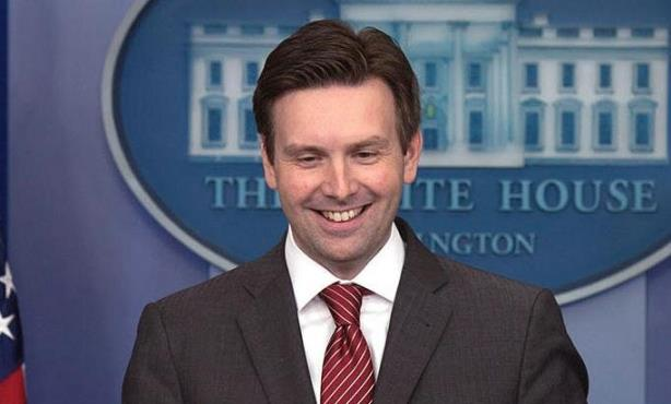White House Press Secretary Josh Earnest was surely not grinning during game one of the World Series on Tuesday night.