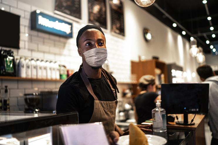 Employees may be more reluctant to un-mask than consumers. (Photo credit: Getty Images).